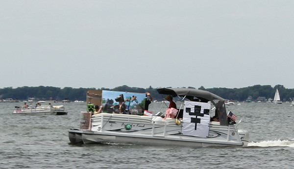 "SHERRY VAN ARSDALL | THE GOSHEN NEWS<br /> The 53rd annual Lake Wawasee Flotilla took place Saturday around the lake. Particpants decorated their boats to the theme, ""Get Your Game On."""
