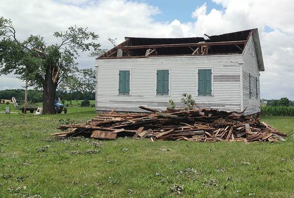 JULIE CROTHERS | THE GOSHEN NEWS<br /> St. John's Lutheran Church, located on the corner of C.R. 32 and C.R. 15 west of Goshen, was damaged during Tuesday's early morning storm. The east side of the roof was torn off and scattered across the cemetery and into a nearby cornfield.