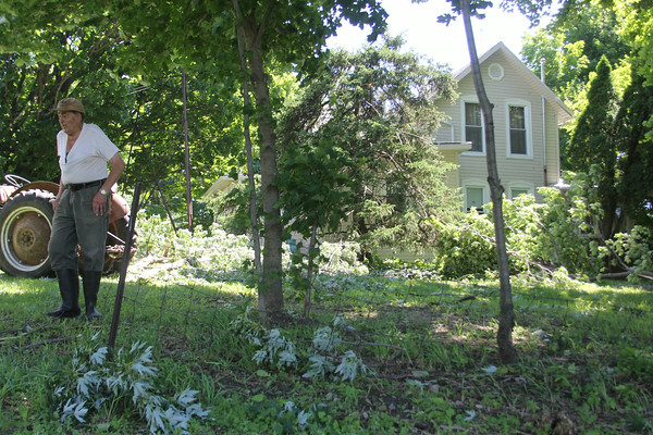 JULIE CROTHERS |THE GOSHEN NEWS<br /> <br /> Robert Wenger surveys his property Tuesday on Ind. 119 near C.R. 38 where he says a tornado ripped through nearby trees, tossing branches into his yard.