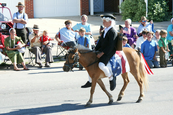 SHEILA SELMAN | THE GOSHEN NEWS<br /> Paul Revere? Maybe not. This young patriot and his small horse had many parade watchers smiling Friday in downtown Topeka.