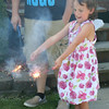 SHEILA SELMAN | THE GOSHEN NEWS<br /> Kylie Singleton, 6, of Wolcottville, watches her sparklers sizzle at a relative's home in Topeka Friday.