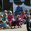 SHEILA SELMAN | THE GOSHEN NEWS<br /> Children scramble onto Lake Street to grab candy as a police car drives by Friday during Topeka's July 4 celebration.