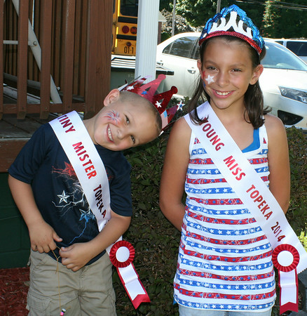 SHEILA SELMAN | THE GOSHEN NEWS<br /> Tiny Mister Topeka Noah Cleveland, 3, and Young Miss Topeka Kaylee Barger, 9, pose for a photo together Friday during Topeka's July 4 festivities.