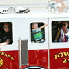 SHEILA SELMAN | THE GOSHEN NEWS<br /> A young boy waves to the crowd from a Shipshewana Fire Department truck during Topeka's annual July 4 celebration parade Friday.