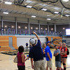 Roger Schneider | The Goshen News<br /> A WITNESS points to the remaining suspended batting cage at the Goshen College Recreation and Fitness Center while the one that fell from the ceiling Monday night  is on the floor in the background.