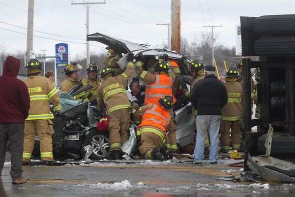 SAM HOUSEHOLDER | THE GOSHEN NEWS<br /> An afternoon crash at the intersection of U.S. 20 and Ind. 15 sent at least one person to the hospital. Two semi-trucks and an SUV were involved. The driver of this SUV had to be extracted after one of the semis overturned on top of it.
