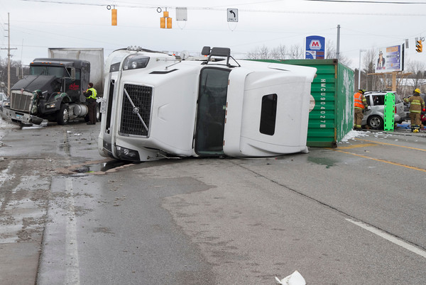 SAM HOUSEHOLDER | THE GOSHEN NEWS<br /> A three-vehicle crash at the intersection of U.S. 20 and Ind. 15 sent at least one person to the hospital Wednesday afternoon. Two semi trucks and an SUV were involved. The driver of the SUV had to be extracted from the veicle when one semi overturned onto the SUV.
