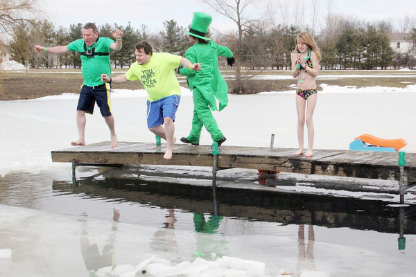 SHERRY VAN ARSDALL | THE GOSHEN NEWS<br /> A group of Leprechaun Leapers take the plunge in the pond near Goshen Moose Lodge for the annual Leprechaun Leap, a fundraiser for United Cancer Services of Elkhart County.