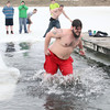 SHERRY VAN ARSDALL | THE GOSHEN NEWS<br /> A Leprechaun Leaper hurries out of the pond near Goshen Moose Lodge after a freezing dip for the annual Leprechaun Leap, a fundraiser for United Cancer Services of Elkhart County.