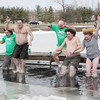 SHERRY VAN ARSDALL | THE GOSHEN NEWS<br /> A group of Leprechaun Leaperstake the plunge in the pond near Goshen Moose Lodge for the annual Leprechaun Leap, a fundraiser for United Cancer Services of Elkhart County.
