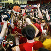 "CHAD WEAVER | THE GOSHEN NEWS<br /> Westview students swarm Westview senior Jamar Weaver at mid-court as Weaver holds on the ""Regional and Semi State Champions"" sign following Saturday's 2A semi-state at Huntington North High School. Westview won 65-58."