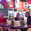SAM HOUSEHOLDER | THE GOSHEN NEWS<br /> From left, Mike Zent, Mark Miller and Rick Hetler, all of Goshen, watch NCAA Tournament games Friday at Buffalo Wild Wings in Goshen.
