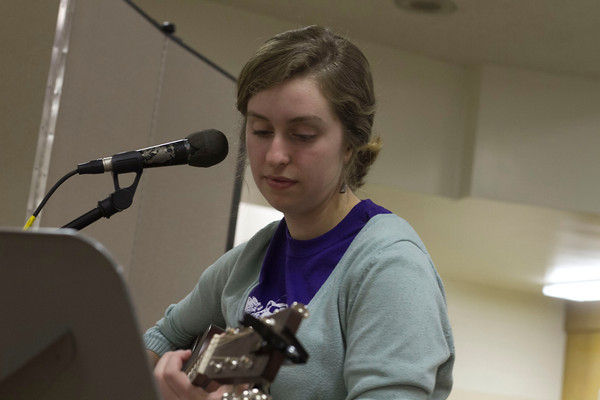 SAM HOUSEHOLDER   THE GOSHEN NEWS<br /> Goshen College freshman Sadie Gustafson-Zook plays a song at Goshen City Church of the Brethren Friday during First Friday Live & Local. The event featured live music at several downtown Goshen locations.