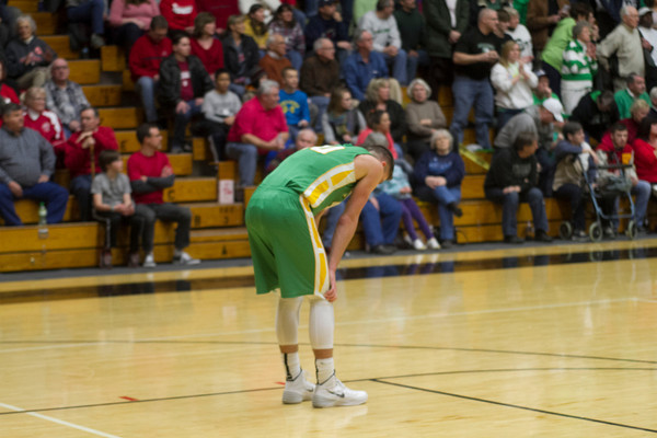 Northridge senior Nate Richie looks down after the Raiders feel to the Concord Minutemen Friday in the 4A Sectional Semifinal at North Side Gym.