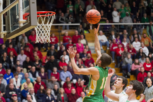 SAM HOUSEHOLDER | THE GOSHEN NEWS<br /> Northridge junior Collin Utley goes up for a basket during the game against Concord Friday in 4A Sectional at Northside Gymnasium in Elkhart.