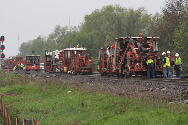 SAM HOUSEHOLDER | THE GOSHEN NEWS<br /> Railroad workers for Norfolk Southern work on laying he tracks along U.S. 33 Wednesday northwest of Goshen.