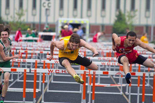 SAM HOUSEHOLDER | THE GOSHEN NEWS<br /> Northridge juniopr Austin Healey runs the 110 meter hurdles during the NLC Championship meet Tuesday at Warsaw High School.