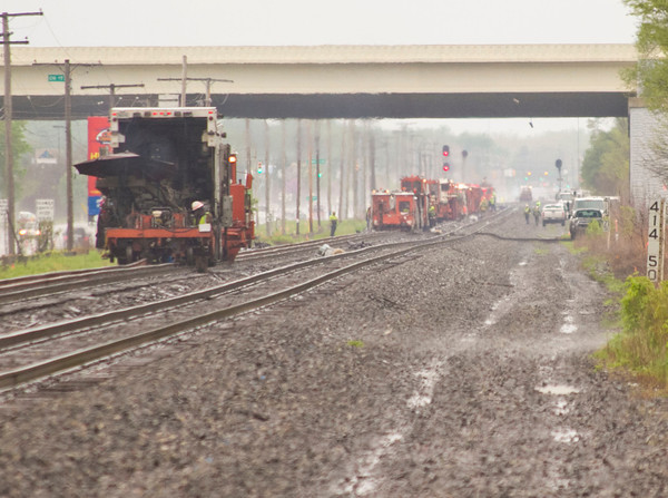 SAM HOUSEHOLDER | THE GOSHEN NEWS<br /> Equipment stretched for miles on the railroad tracks along U.S. 33 Wednesday northwest of Goshen as Norfolk Southern worked on installing rails.