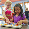 SAM HOUSEHOLDER | THE GOSHEN NEWS<br /> Emily Smith, left and Angelic Romero play with a puzzle at Eighth Street Preshool Wednesday in Goshen. The school has been serving Goshen youngsters since 1974.