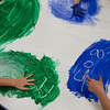 SAM HOUSEHOLDER | THE GOSHEN NEWS<br /> Pre-school children draw numbers and letters in fingerpaint Tuesday at their class at Prairieview Elementary School in Goshen. The preschool program is in danger of being cut due to federal waiver loses by the state.