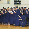 "JOHN KLINE | THE GOSHEN NEWS<br /> Members of the Bethany Christian High School class of 2014 sing the congregational hymn ""God of the Bible"" during graduation ceremonies Sunday in the school gym."