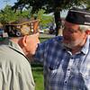 BOB COTHERMAN, a Navy World War II veteran, left, and member of Veterans of Foreign Wars Post 985, is thanked for his service to his country by George Buckmaster of the VFW. Buckmaster was a bugler at the Goshen  Memorial Day service on the courthouse lawn before the annual parade. Cotherman also placed a wreath in the Elkhart River to honor those who died at sea defending the United States.
