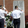 SAM HOUSEHOLDER | THE GOSHEN NEWS<br /> Nappanee American Legion Post 154 members Terry Ruff, left and Jim Creech salute the memorial wreath placed in front of the Memorial rock at the Nappanee Municipal Building Monday during the town's Memorial Day service.