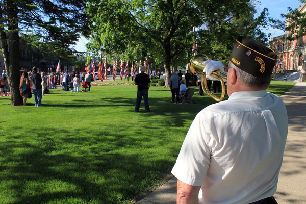 Roger Schneider | The Goshen News<br /> BUGLER GEORGE BUCKMASTER plays echo Taps at the Goshen Memorial Day service Monday. On the other side of the courthouse lawn was bugler Phil Whitehead.