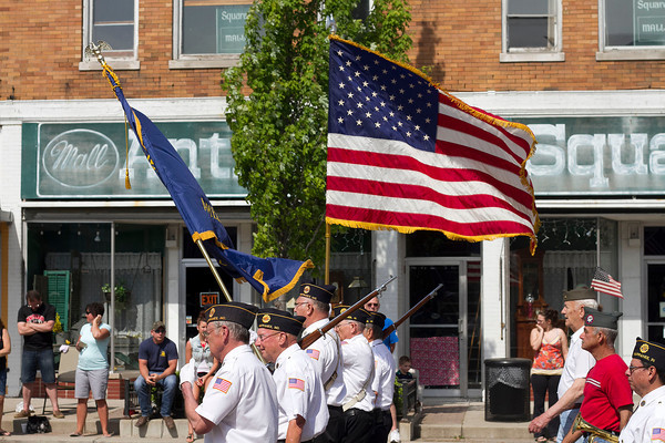 SAM HOUSEHOLDER   THE GOSHEN NEWS<br /> Members of the Nappanee American Legion Post 154 carry the flag and lead the town's Memorial Day Parade Monday down Main Street.