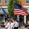 SAM HOUSEHOLDER | THE GOSHEN NEWS<br /> Members of the Nappanee American Legion Post 154 carry the flag and lead the town's Memorial Day Parade Monday down Main Street.