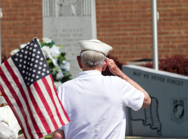 SAM HOUSEHOLDER | THE GOSHEN NEWS<br /> Navy veteran Ed McElheny salutes during the playing of Echo Taps Monday at the Nappanee Memorial Day Service.