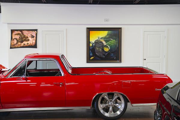 SAM HOUSEHOLDER | THE GOSHEN NEWS<br /> A classic Chevrolet El Camino and original artwork from Elkhart artist Dean Loucks are shown inside the Toy Barn car dealership in Goshen Friday.