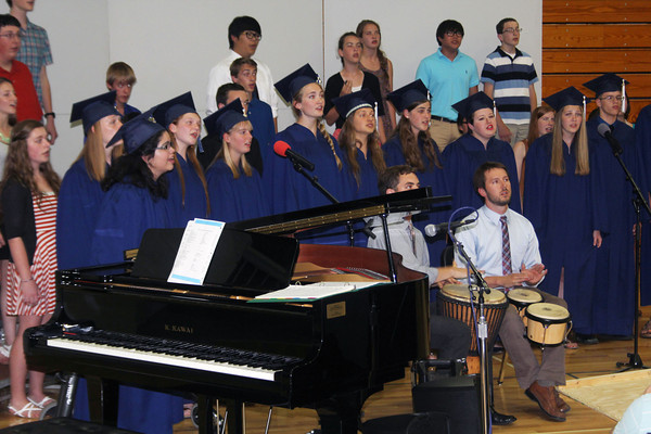 "JOHN KLINE | THE GOSHEN NEWS<br /> Members of the Bethany Christian concert choir perform ""It Takes a Village"" by Joan Szymko during a commencement ceremony Sunday afternoon in the school gym."