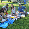 JOHN KLINE | THE GOSHEN NEWS<br /> Residents of the newly formed West Goshen Neighborhood Association, from left, Andres Dixon, Ava Dixon, Michael Smith, Rachael Baker and Jimmy Dixon, take a break from their picnic to smile for the camera during the association's first annual summer block party at Bakersfield Park in the West Goshen neighborhood Saturday afternoon.