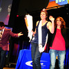 SHERRY VAN ARSDALL | THE GOSHEN NEWS<br /> Anita Shank was the top winner in the Mama Mania Feud held at Grace Community Church in Goshen to celebrate Mother's Day. At left, Youth Pastor Dan Cosentino was emcee and Director of Remarkable Women, Shali Yoder, arranged the event.