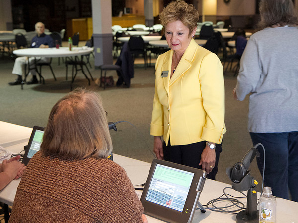 SAM HOUSEHOLDER | THE GOSHEN NEWS<br /> Indiana Secretary of State Connie Lawson talks with poll worker Connie Garber Tuesday at Maple City Chapel during the primary election. Lawson was visiting Elkhart County which is using the new vote center system for the first time.