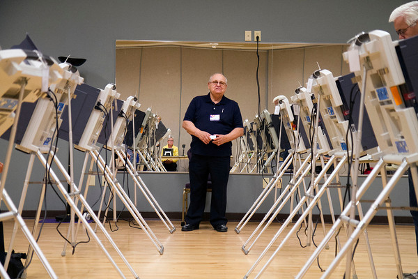SAM HOUSEHOLDER | THE GOSHEN NEWS<br /> Election sheriff Jesse Kehr looks over the voting center at Greencroft Goshen Senior Center Tuesday during the election. The election was the first using the county's new electronic voting center.