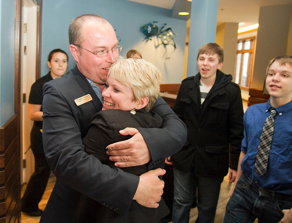 SAM HOUSEHOLDER | THE GOSHEN NEWS<br /> Curt Nisly hugs his wife Mary after hearing he had won the Republican nomination for District 22 state representative Tuesday at Oakwood Inn in Syracuse as sons Ben, 19, left and Curtis, 15 look on. Nisly defeated incumbent Rebecca Kubacki.