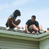 SHERRY VAN ARSDALL | THE GOSHEN NEWS<br /> Goshen College students volunteered their time to put a new roof on the home of Angelina Ram during LaCasa's Annual Help-A-House Community Work Day Saturday.