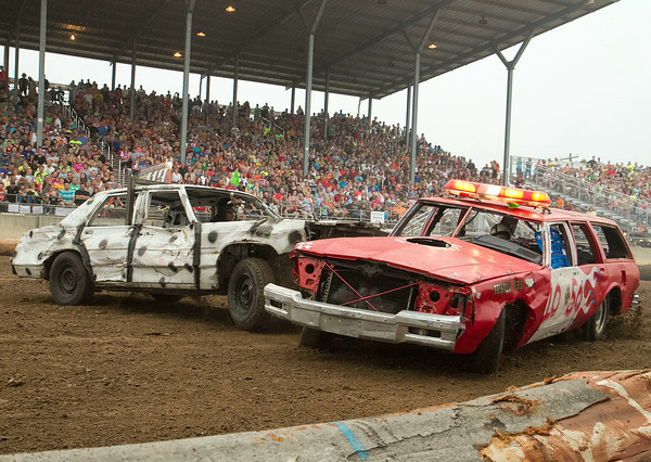 SAM HOUSEHOLDER | THE GOSHEN NEWS<br /> Tow cars collide during the firefighter's heat of the Nationwide Demolition Debry Saturday at the Elkhart County 4-H Fair. Firefighters from local departments compete for a traveling trophy at the derby every year.