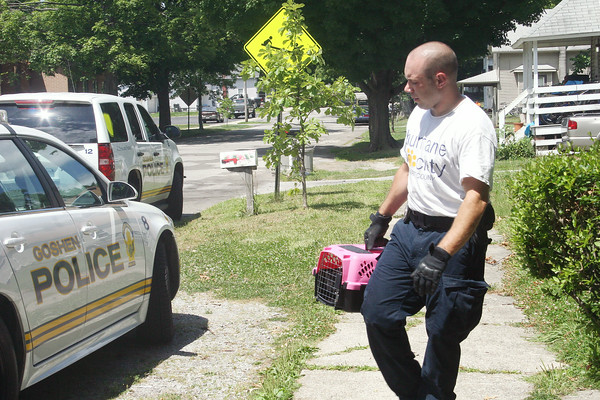 SHERRY VAN ARSDALL | THE GOSHEN NEWS<br /> Goshen police and Humane Society of Elkhart County officer Dan Scott removed abandoned animals from the residence at 416 N. Eighth Street in Goshen.