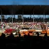 SAM HOUSEHOLDER | THE GOSHEN NEWS<br /> Spectators watch a tractor make a run Thursday at the grandstand during the tractor pull at the Elkhart County 4-H Fair.