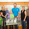 SAM HOUSEHOLDER | THE GOSHEN NEWS<br /> Grand Champion meat pen rabbits belonged to Natalie Yoder, center, of Milersburg, daughter of Laurie and Glen, to her left and right, Laurie is holding Wes and Brad is on the left in the front with Emily on the left. Buyers include Dr. Paul and Cathy Webb, iof Millersburg Animal Clinic.
