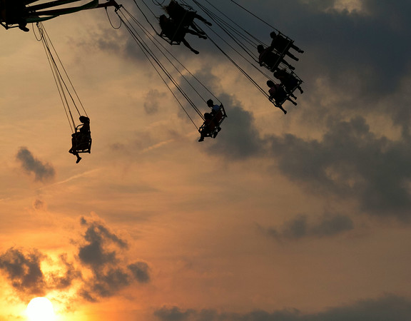 SAM HOUSEHOLDER   THE GOSHEN NEWS<br /> Fairgoers enjoy taking a ride on the Vertigo Sunday night at the Elkhart County 4-H Fair.