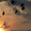 SAM HOUSEHOLDER | THE GOSHEN NEWS<br /> Fairgoers enjoy taking a ride on the Vertigo Sunday night at the Elkhart County 4-H Fair.