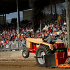 SAM HOUSEHOLDER | THE GOSHEN NEWS<br /> Bill Jessup, Goshen, takes a run during the tractor pull at the Elkhart County 4-H Fair Thursday. Jessup has been participating in the tractor pull for 39 years.