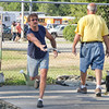 SAM HOUSEHOLDER | THE GOSHEN NEWS<br /> Greg Jones tosses a horseshoe Wednesday at the Elkhart County 4-H Fair. Jones plays at the fair and uses his father's horseshoes.