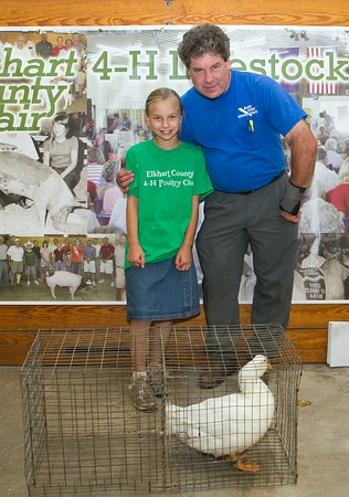 SAM HOUSEHOLDER | THE GOSHEN NEWS<br /> The Grand Champion duck belonged to Hannah Diener, shown here with her father Ira, who was among the buyers group.