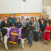 SAM HOUSEHOLDER | THE GOSHEN NEWS<br /> Grand Champion Dairy Feeder Calf belonged to Zachary Klotz, of Etna Green, front right. Buyers include, front from left, Brent Carrick, First State Bank, Tim Klotz, father of seller, Caroline Mullett, a cousin of the seller, Klotz, Gary Yoder, of Yoder Carpets, Junnell Stutzman, mother of seller, Troy Cutter, friend and Max Mullett, cousin. Back row, from left includes, Bert Egging, Egging Family and the Elkhart County Farm Bureau and Cooperative Board,  Larry Struble, representing Martin's Supermarkets, Jim Weeber, of Weeber Farms, Stephanie Topping of Topping Dental and Terry and Rod Mullet of Rod's Trademark Remodeling and Monte Flowers.