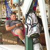 SAM HOUSEHOLDER | THE GOSHEN NEWS<br /> Jake Snider, Nappanee, 18, sits on a hammock in the Beef Steer Barn Wednesday at the Elkhart County 4-H Fair. Snider, a 10-year 4-H member, was watching over his own two steers as well as those of some friends.
